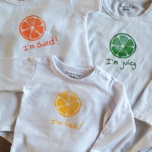 Babyromper met citrusprint